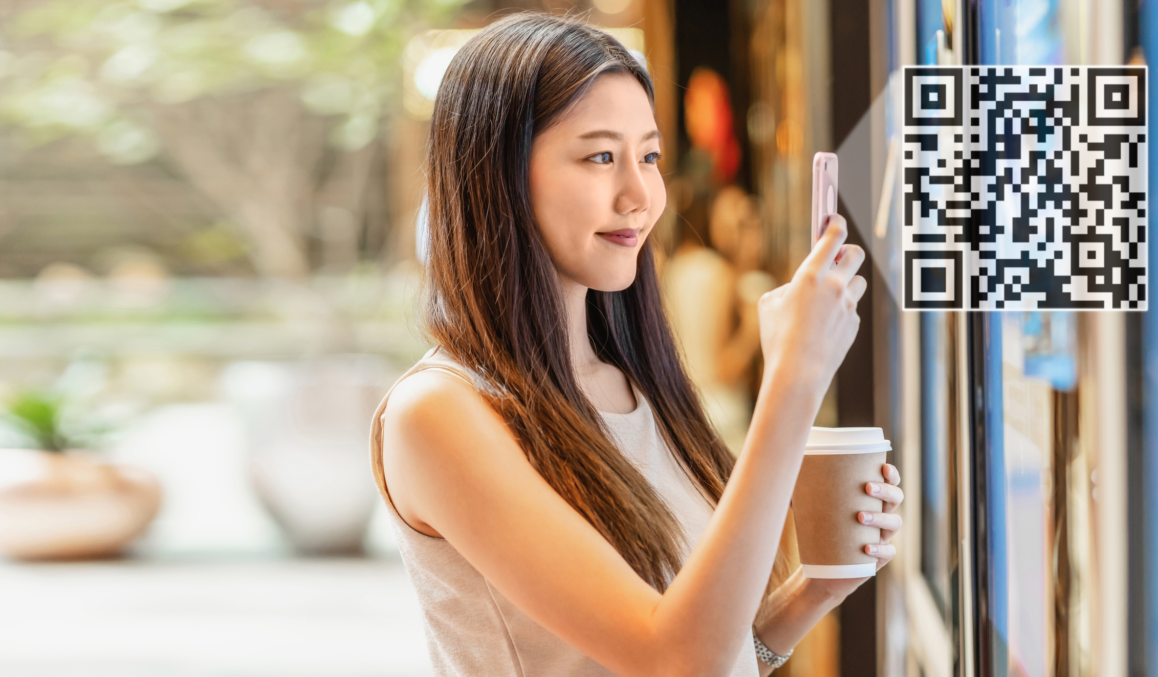 Woman scanning window QR to place order